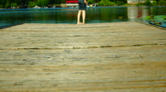 My Bare Foot  On Wooden Pier.Girl In Shorts Walking On A Wooden Pier Stock Footage