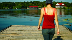 Bare Foot  On Wooden Pier.Girl In Shorts Walking On A Wooden Bridge Stock Footage