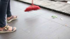 Female sweeping floor Stock Footage