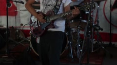 Band is playing on base guitar on the concert Stock Footage