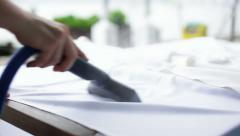 Ironing tablecloth - stock footage