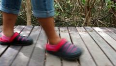 Foot steps walking on the wooden stairs Stock Footage