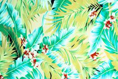 Texture fabric Vintage Hawaiian flowers and leaves for background Stock Photos