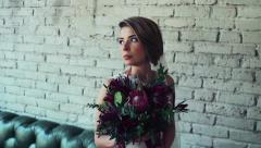 Stock Video Footage of wedding photoshoot in a studio agaist the white brick wall slow motion