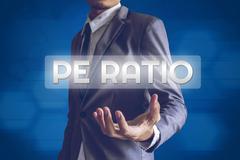 Businessman or Salaryman with PE Ratio text modern interface concept. Stock Photos