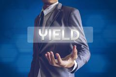 Businessman or Salaryman with Yield text modern interface concept. Stock Photos