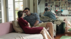 Couple sitting on the sofa and decide to leave the room Stock Footage