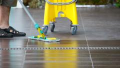 Male mop the floor - stock footage