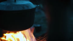 Pot on the campfire, low light Stock Footage