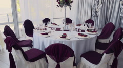 Wedding decorations of a round table in a restaurant slow motion Stock Footage