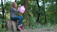 Young woman eating cotton candy in park Stock Footage