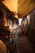 Dirty back alley in India - stock photo