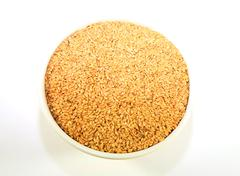 A bowl of golden linseed - stock photo