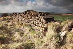 Sunlit dry stone wall - stock photo