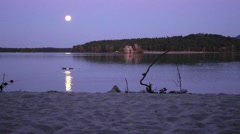 Time lapse. Romantic full moon night at lake, calm water level with moon rays Stock Footage