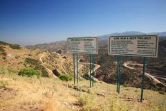 Signpost for Cine Dam - stock photo