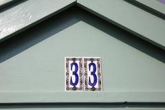 Beach hut number 33 - stock photo