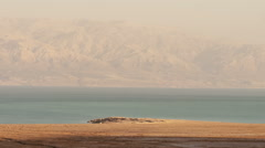 Time lapse of shadows moving over shore of Sea of Galilee. Cropped. Stock Footage