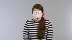 Woman mime with scissors cuts the credit card. Concept: bankruptcy, insolvency - stock footage