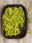 rustic british mushy peas - stock photo