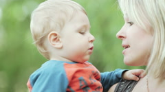 Child on hand his mother - stock footage