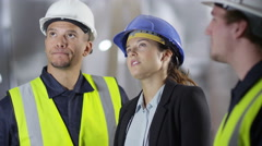 4k female engineer or architect discussing construction with male colleagues Stock Footage