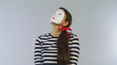Woman mime gets dollars from hats. Concept: sudden wealth Stock Footage