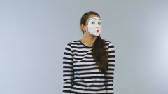 Woman mime shows a sign advertising Stock Footage