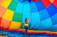 Girl and a hot air balloon Stock Photos