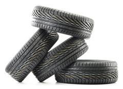 Four new black tires isolated on white background Stock Photos