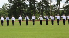 Students in Uniform Salute at Parade Stock Footage