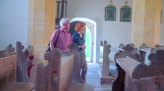 Stock Video Footage of Two Christians walking into church