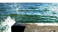 Water crashes up on concrete dock, 4K Stock Footage