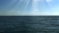 Sunshine over calm blue sea, 4K Stock Footage