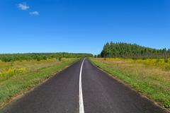 Country asphalt highway with one line of solid white road markings - stock photo