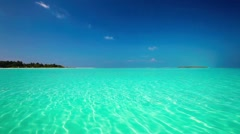 Romantic sandy beach with amazing clean lagoon in Maldives - stock footage