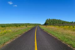 Country asphalt highway with one line of solid yellow road markings Stock Photos