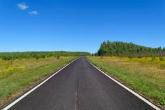 Country asphalt highway with two line of solid white road markings - stock photo