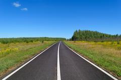 Stock Photo of Country asphalt highway with three line of solid white road markings