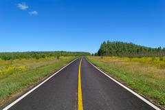 Stock Photo of Highway with one line of yellow and two line of white solid road markings