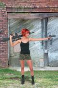 Woman with Assault Rifle and Handgun Stock Photos