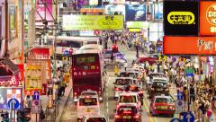 4k timelapse video of pedestrians and traffic in a busy street in Hong Kong Stock Footage