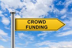 yellow road sign with crowd funding words - stock photo