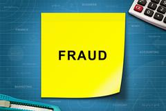 Fraud word on yellow note Stock Photos