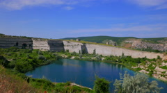 Quarry abandoned stone open pit filled with blue water. Stock Footage