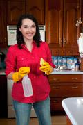 Stock Photo of Woman Cleaning House