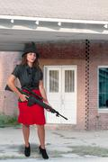 Woman with Assault Rifle - stock photo