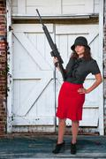 Stock Photo of Woman with Assault Rifle