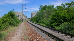 The railway line receding into passage in the rock. - stock footage