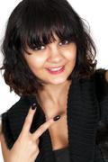 Woman flahing a gang sign - stock photo